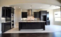 This large open kitchen features a modern look #ShaddockHomesTX #Kitchen #KitchenDesign
