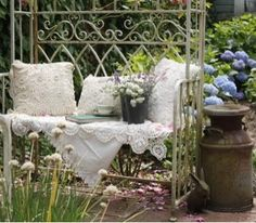 """Bella Rose Cottage...  I haven't been able to afford or find the right cushion or pillows for my bench arbor.  Love the look of a table cloth hanging over at an angle & I could cover some of my (""""tired of"""" pillows) with some cute cottagey fabric."""