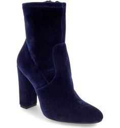Velvet is one of the biggest trends for fall. Try rocking a pair of blue velvet boots like these ones from Steve Madden.