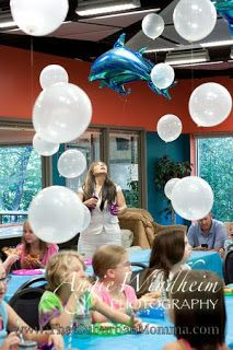 Under the Sea/ Mermaid Birthday Party. Clear balloons to look like bubbles and dolphins.