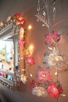 DIY flower garland for girls room decor using dryer sheets–great idea for recycling dryer sheets