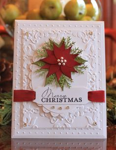 Sweetpea Samplings: Poinsettia card with lots of embossed layers. Poinsetta uses build a bird punch