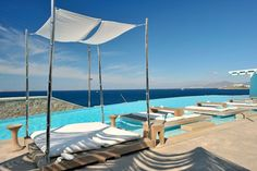 The Greek Islands always make for a perfect holiday and Mykonos is one of personal favourites - surrounded by . Villas, Porches, Cavo Tagoo Mykonos, Mykonos Hotels, Porch Addition, Beach Cottage Style, Beach Cottages, Beach Houses, Facades