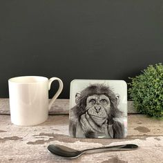 Chimp Glass Coaster by British artist Sarah Boddy. Features a beautiful illustration of a chimp on our hardwearing recycled glass coaster. The lovely black and white artwork makes it a striking addition to any home! Swinging Safari, Flamingo Decor, Black And White Artwork, Great Gifts For Dad, Presents For Friends, Glass Coasters, Animal Decor, Safari Animals, New Home Gifts
