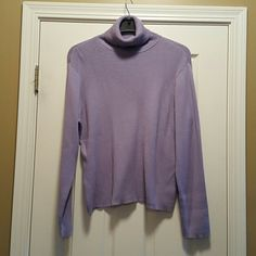 Pretty purple turtleneck top! This is a very pretty long sleeve turtleneck in a lilac/periwinkle color! The fabric is heavier fabric, yet still lightweight. It is stretchy and loose fitting and comfy! It looks great under a jacket, or on it's own! The inside tags have been cut off (price reduced accordingly), but this fits a size 18. This shirt is in excellent condition! Tops