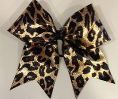 Items similar to Black and Gold Cheetah Cheer Bow on Etsy Dance Bows, Cheer Dance, Cheerleading Bows, Cheerleading Uniforms, Cute Cheer Bows, Big Bows, Hair Ribbons, Ribbon Bows, Cheer Athletics Cheetahs