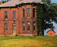This huge Italianate house is along US 31 between Indianapolis and South Bend, right by the side of the road. I think the green paint on the trim is original and is a little unusual for this style. Almost all of these were originally trimmed in white. It appears well kept but uninhabited.