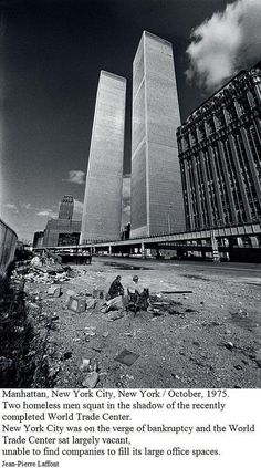 Two homeless men squat in the shadow of the recently completed World Trade Center in October 1975.