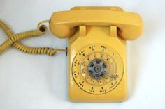 yellowloves:    Yellow Rotary Dial Vintage Telephone (by TheNewtonLabel)
