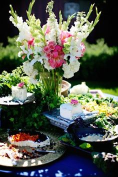 Really love this pink and white gladiola arrangement with navy tablecloths.