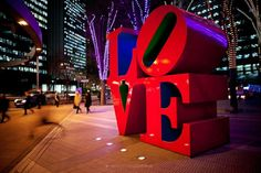 TOKYO, JAPAN, 26 JANUARY - Shinjuku - Salarymen are walking in front of the famous LOVE sculpture created by Robert Indiana. This business area of shinjuku is made by very high tower building - January 2012 Victor Pasmore, Shinjuku Tokyo, Tokyo Japan, Love Statue, Love Is, Tower Building, Swiss Design, Big Letters, Valentines