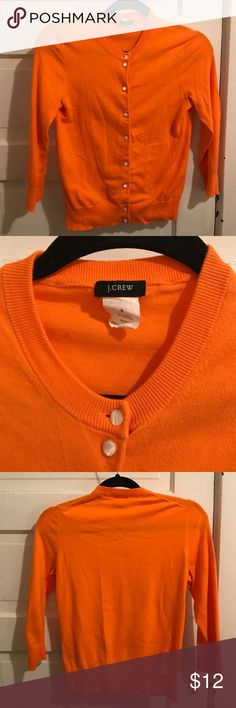 J Crew Orange Knit Cardigan Vibrant, lightweight, 3/4 sleeve J Crew knit cardigan in beautiful bright orange. Pearlescent buttons. Wrinkled from closet but absolutely no flaws or sign of wear. Adorable! J. Crew Sweaters Cardigans