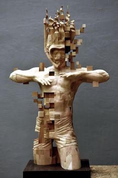 Pixelated wood statue.