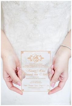 Simple white transparent  acrylic wedding  invitation with gold pattern and calligraphy, any season appropriate
