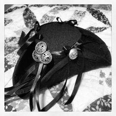 DIY Mini Pirate Tricorn Hat - based on this website: http://www.fleecefun.com/make-mini-pirate-hat-or-mini-tricorn-hat.html