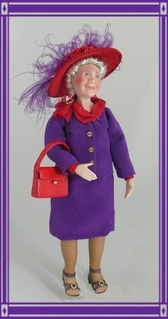 """Gertie"" is ready to lunch w/ the red hat gals!  She's dressed in her very favorite purple suit.  A red silk scarf is held neatly in place w/ a ruby jeweled pin.  Her real panty hose are the support kind & her purple leather sandals have sensible heels!  Her handbag is red leather.  Her hat is silk (red,of course) & is trimmed w/ loads of red roses, green velvet leaves & purple feathers. From 'Daisy's Dollhouse Miniatures.'"