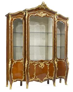A Louis XV style gilt bronze mounted parquetry vitrine cabinet, fourth quarter 19th century.