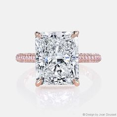 CHELSEA PINK Diamonds solitaire engagement ring, shown set with an Oval cut diamond in 18K Rose Gold with 3 rows of Argyle* pink diamonds on the band.