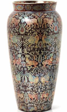 Zsolnay A Lustre Vase with Bird and Animal Motifs, circa 1900 painted with symmetrical pairs of animals and birds in golden, red and turquoise lustre amid dense foliage on a purple ground 34cm high, raised circular 'Five Churches' 'Zsolnay Pecs' mark to base (some restoration to rim) Bo14/E1625L