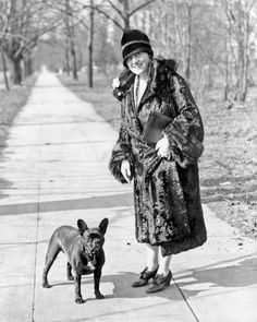 Mary Roberts Rinehart, well known writer often called the american Agatha Christie, snapped while out for a stroll with her favorite pet. 1920s