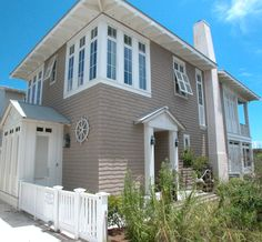 A Seaside, FL, home inspired by nautical shipwheels and the movie Summer of 42 by Toby West.