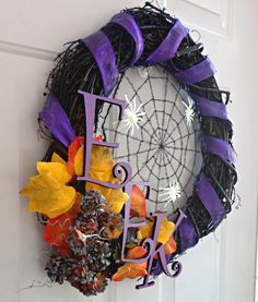 A neat and easy Halloween wreath DIY using dollar store finds. Two different Halloween wreath ideas.
