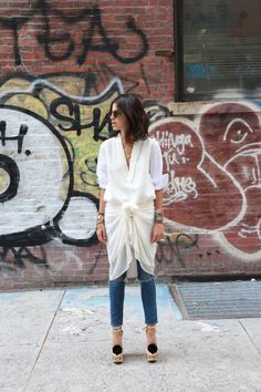 sneakers and pearls, street style, dress over jeans, white shirt under a chiffon dress, master of layering, Leandra, trending now
