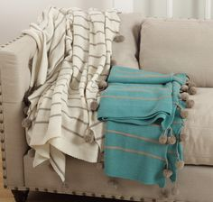 Pompom design throw in ivory and turquoise