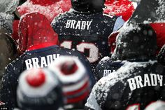 Patriots fans turned out en masse wearing the replica jerseys of their hero Brady as the snow began to fall in Boston