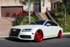 White Audi S7 on red forgiatos