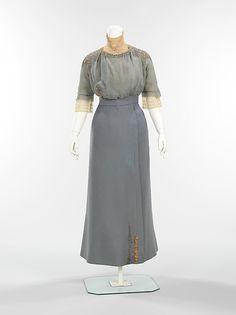 Walking suit (a–c) House of Paquin Designer: Mme. Jeanne Paquin (French, 1869–1936) Designer: (d) Thurn (American) Date: spring/summer 1910 Culture: French Medium: wool, metal, silk