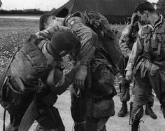 Prior to their D-day jump into Normandy, members of the 82nd Airborne check over their gear. Like the 101st, the 82nd was spread out over miles of Norman countryside in the pre-dawn darkness of June 6, 1944.