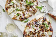 A simple recipe for Grilled White Pizza loaded with 3 cheeses, fresh basil, caramelized mushrooms and slivered red onions! Pure perfection.