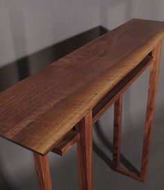 This narrow table design with inset shelf is perfect for a hall table, small console table or entryway table.  As a sofa table, the smart height lets you access the shelf from both sides.  Hand-crafted in Virginia, Mokuzai is modern solid wood furniture