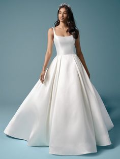 Selena| Mikado scoop neck ball gown with covered buttons. #wedding #weddingdresses #weddingdress #bride #bridal #bridalgown #weddingplanning #weddingfashion #maggiesottero