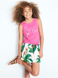Oasis Graphic Tie Tank, Drapey Pocket Shorts, and Gladiator Sandals | Gap Kids