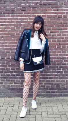 """Amsterdam Fashion Week report -  As first seen on blog """"A Dash Of Fash"""" here: Amsterdam Fashion Week report  She is wearing tights similar here: Black Fishnet Tights Oversized fishnet cutouts put an edgy spin on high-waist tights that look stylish on their own or layered over opaque styles for an eye-catching look.  #tights #pantyhose #hosiery #nylons #tightslover #pantyhoselover #nylonlover #legs"""