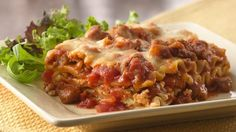 Italian Sausage Lasagna ~ No need to buy frozen lasagna when you have this much-loved recipe on hand. Paula Deen, Italian Dishes, Italian Recipes, Spanish Recipes, Chinese Recipes, Mexican Dishes, Pasta Dishes, Food Dishes, Main Dishes