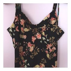 Floral midi dress | F21 NWOT. Absolutely stunning floral midi dress from Forever 21. The material is extremely soft, stretchy, and hugs your curves. Straps are adjustable. Forever 21 Dresses Midi