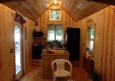 Another DIY Tiny Home on Wheels: The Tiny Blue House Photo The kitchen island is mobile so you can flip the table down and move the island over.