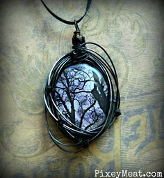 Creepy Dead Tree Necklace Black and White Gothic Wire Wrapped Pendant Jewelry. via Etsy.