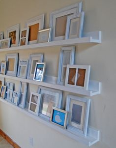 Plans for simple ten dollar ledges from Ana White. Each 8 foot long photo ledge costs Photo Ledge, Photo Shelf, Picture Shelves, Picture Frames, Picture Walls, Ikea Picture Ledge, Photo Walls, Home Organization Hacks, Home And Deco
