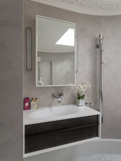 Inspiring bathroom design, a freestanding bathroom sink and cabinet is the perfect bathroom storage solution to hide away all those toothbrushes and other bathroom accessories. Wall lights either side of the mirror adds that crucial hued lighting effect....