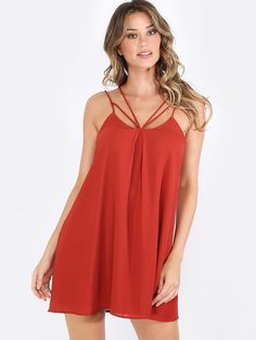 """Take a step into fabulousness with the Strappy Shift Dress! Features spaghetti straps, sexy strappy front design cut outs, and a classic shift silhouette. Dress measures 23.5"""" approx. from shoulder to hem. Wear with backless mules and layered jewelry!"""