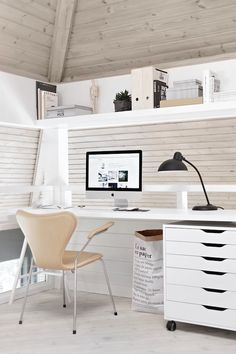 Home office space in a the loft of a serene Norwegian home on a hill. Nina Holst.