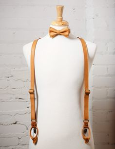 """---These are genuine FULL GRAIN LEATHER suspenders HANDMADE IN US ---    Suspender details:    • 1"""" wide double sided straps   • Adjustable straps  • Antique brass clips  • Neatly packaged in a cotton bag with tags (Perfect as a gift!)  • Matching leather bow tie available (Receive 15% OFF bow tie and suspenders when buying together!)  • Handcrafted in New Orleans    Size:    Measure the distance from center-back waistline (diagonally over the shoulder) to the front waistline. When…"""