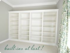 4 ikea bookcases attached with moulding/ Great idea! Love to build things into the walls... this may be easier though.