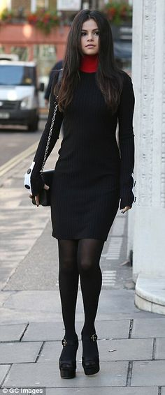 Glam girl: The singer modelled an array of chic yet comfortable looks, keeping the same shoes and tights on