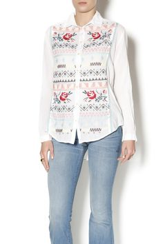 """This beautiful shirt by 3J Workshop (a division of Johnny Was) features vibrant embroidery and a full button closure and a traditional collar. The colorful embroidery contrasts with an elegant white background. The look is casual, yet chic. Put it on with some jeans and boots for a splendid weekend look. It is 100% cotton and the fit is true to size. Machine washable in the cold, gentle cycle. As an example of sizing, the small has an 18"""" shoulder, 43"""" bust, 48"""" hem, and 28.5"""" length…"""