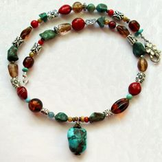 Maggies Beadery womens beaded necklace with a large Turquoise pendant is 22 inches long.
